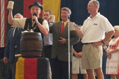 Mayor Tom Henry taps the first keg