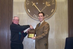 2008/12/16: Smith presents Didier with plaque commemorating his first year as President