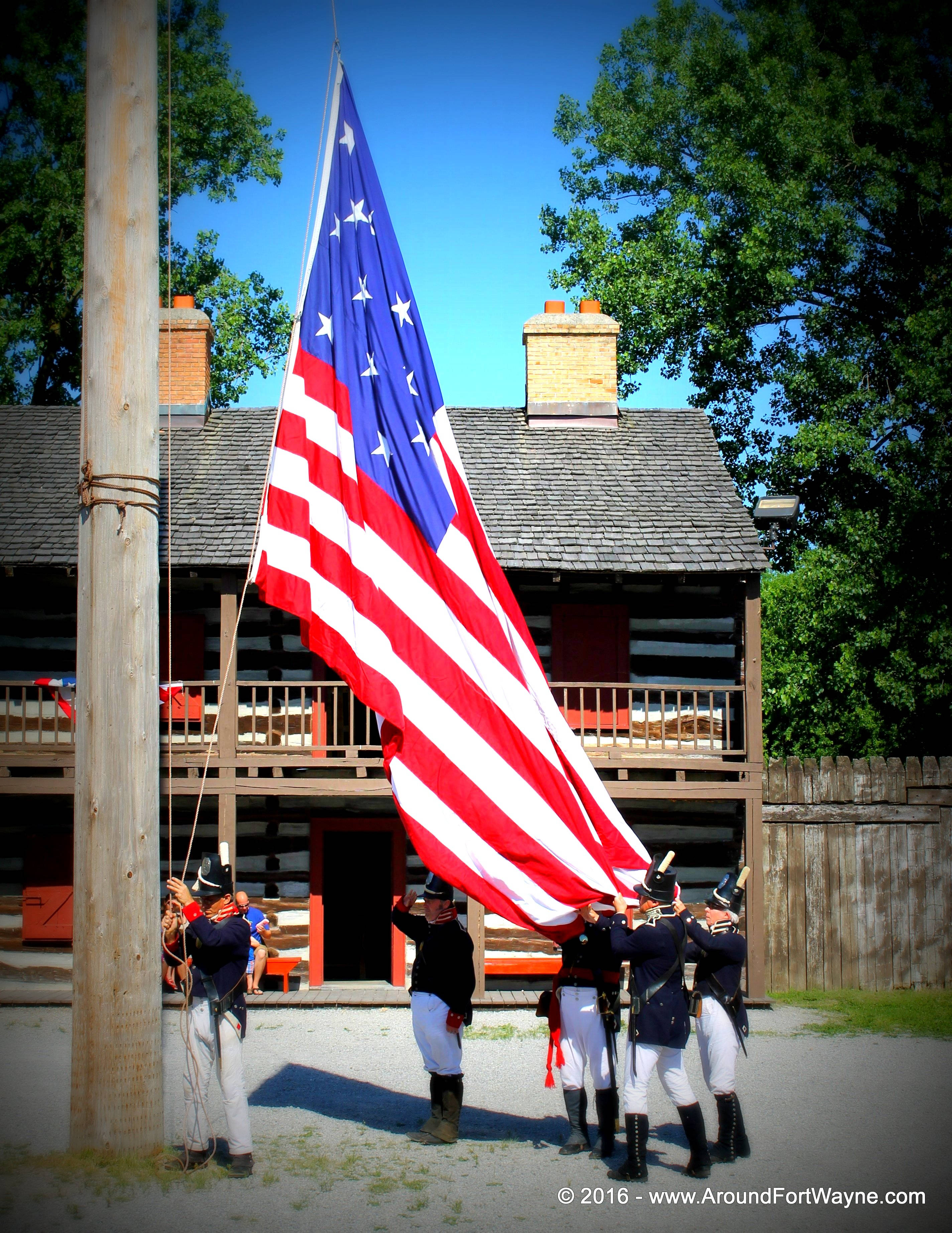 Posting the colors at Old Fort Wayne on June 12, 2016.