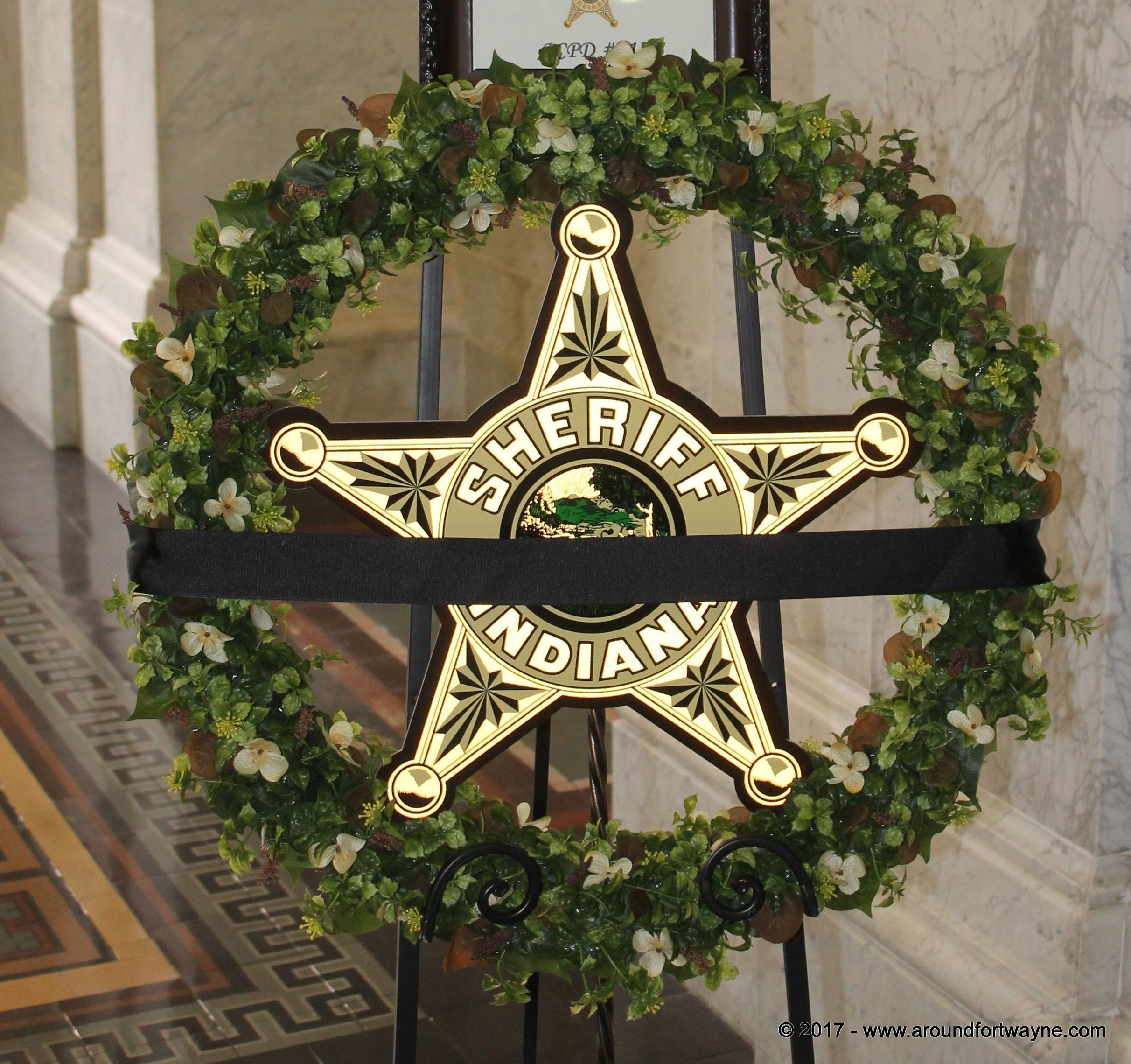 Memorial wreath outside the Allen County Sheriff's office in honor of Sgt. Joseph Cox.